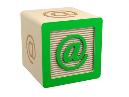 Wooden block with email @ sign