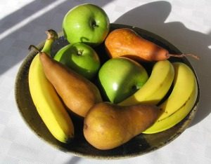 Bowl of fruit including bananas, apples and pears