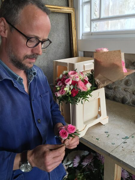Matt Gunn of Gunns Florist designing a bouquet of flowers