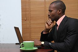 social-media-tips-for-professional-services_man-at-laptop