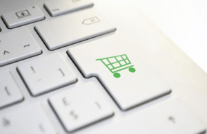 Keyboard with shopping trolley icon.