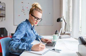 Image of woman at laptop