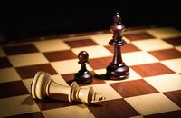 Image of chess pieces on a chess board