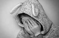 Girl with rabbit ears crying