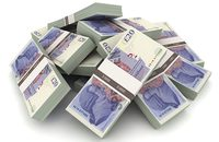 Image of bundles of £20 notes