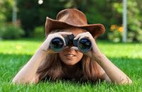 Girl holding binoculars