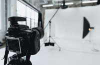 A camera and photography studio with lights and backdrop