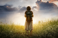 Girl standing at beginning of a journey
