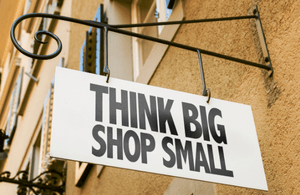"A shop sign saying ""Think big, shop small"""