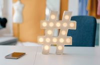 Image of a hashtag sign light on a desk