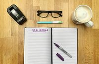 Image of notebook on desk with 2021 Goals heading written on it