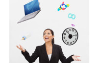 Image of businesswoman juggling a laptop and baby toys