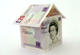 Image of £20 notes making up a paper house